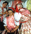 The Bride Receives Her Marriage Bonnet - a photography from the book Slovak Folk Customs and Traditions